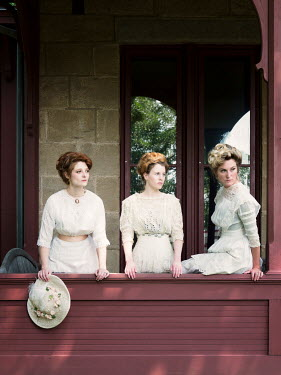 Elisabeth Ansley THREE HISTORICAL WOMEN ON VERANDA OUTSIDE HOUSE