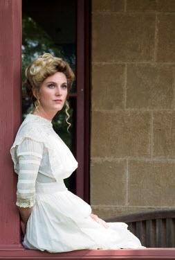 Elisabeth Ansley BLONDE HISTORICAL WOMAN SITTING ON VERANDA