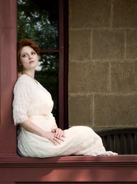 Elisabeth Ansley SERIOUS HISTORICAL WOMAN SITTING ON VERANDA