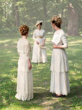 Elisabeth Ansley THREE HISTORICAL WOMEN IN WHITE IN GARDEN