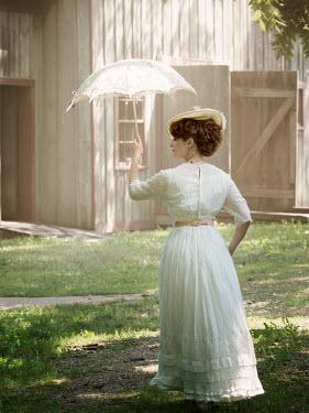 Elisabeth Ansley EDWARDIAN WOMAN IN GARDEN WITH PARASOL