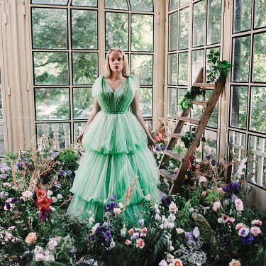 Jovana Rikalo BLONDE GIRL IN CONSERVATORY WITH FLOWERS
