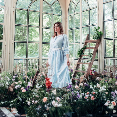 Jovana Rikalo BRUNETTE  GIRL IN CONSERVATORY WITH FLOWERS