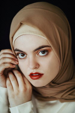 Jovana Rikalo SERIOUS WOMAN WITH BROWN HEADSCARF