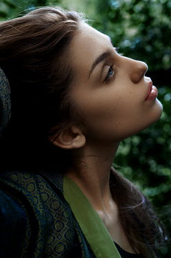 Natasha Yankelevich YOUNG BRUNETTE GIRL DAYDREAMING OUTDOORS