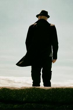 Tim Robinson MAN IN HAT WAITING ON BEACH