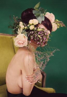 Elena Tyagunova WOMAN SITTING IN CHAIR WITH FLOWERS ON HEAD