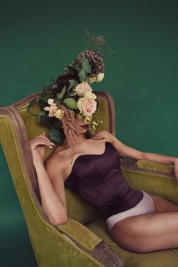 Elena Tyagunova WOMAN IN BODICE SITTING WITH FLOWERS ON HEAD