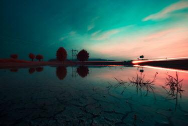 David Keochkerian LAKE AT SUNSET WITH GLOWING LIGHTS