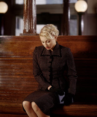 Michael Nelson BLONDE RETRO WOMAN SITTING IN STATION
