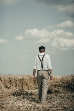 Magdalena Russocka retro man walking in field