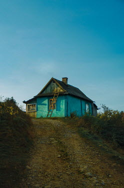 Svitozar Bilorusov SMALL HOUSE WITH LADDER ON HILL