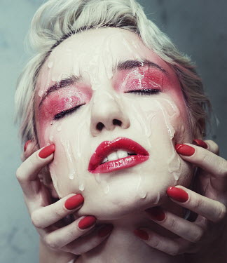 Elena Tyagunova HAND HOLDING FACE OF WOMAN WITH RED MAKE UP