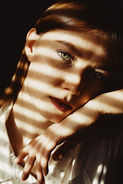 Elena Tyagunova SERIOUS WOMAN WITH RED HAIR AND FRECKLES IN SHADOW