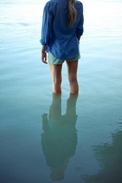 Ildiko Neer Young woman standing in river