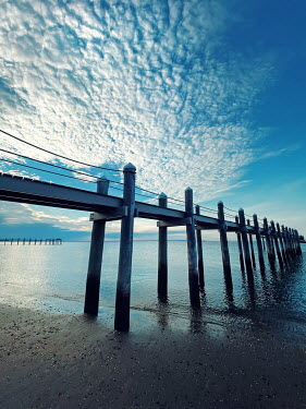 Lisa Bonowicz SANDY BEACH WITH JETTYS AND BLUE SKY