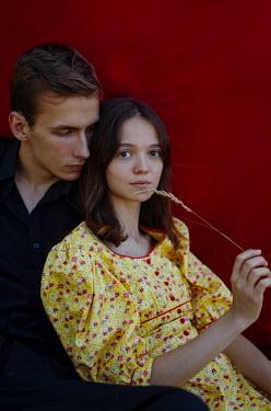 Svitozar Bilorusov SERIOUS COUPLE EMBRACING OUTDOORS