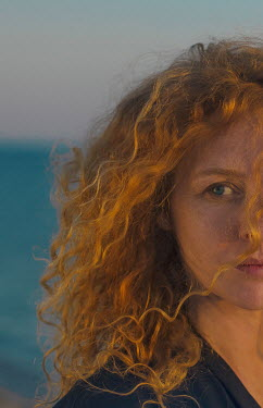 Svitozar Bilorusov SERIOUS WOMAN WITH RED CURLY HAIR BY SEA