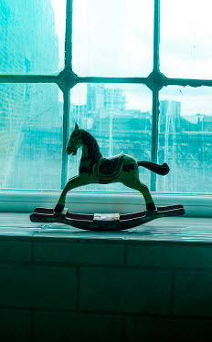 Stephen Mulcahey ROCKING HORSE ON URBAN WINDOW SILL