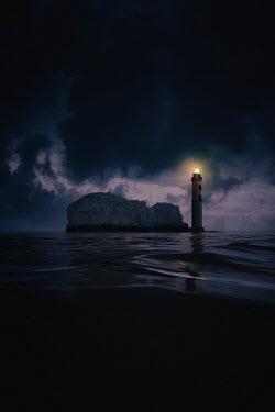 Nic Skerten LIGHTHOUSE ON ROCKY ISLAND AT NIGHT