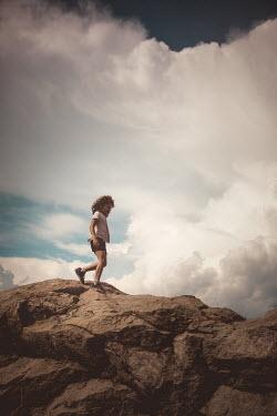 Des Panteva YOUNG GIRL WALKING ON ROCKS
