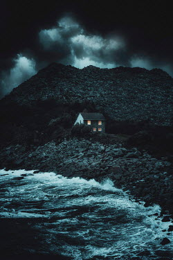 Nic Skerten LIGHTS SHINING IN WINDOWS OF HOUSE BY STORMY SEA
