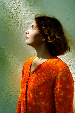 Ute Klaphake BRUNETTE WOMAN STANDING IN SUNLIGHT