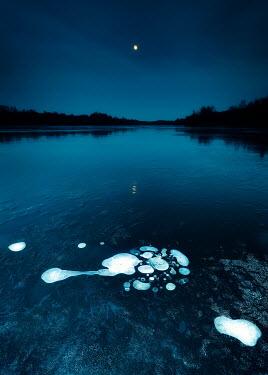 David Keochkerian ICE ON RIVER AT NIGHT WITH MOON