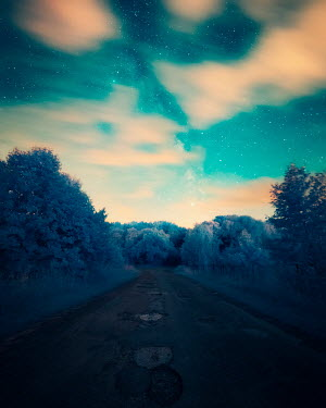 David Keochkerian EMPTY COUNTRY ROAD WITH CLOUDS AND STARRY SKY