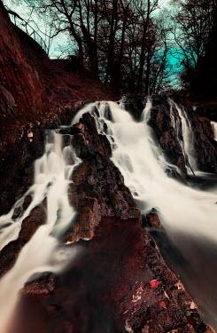 David Keochkerian WATERFALL WITH TREES IN WINTER