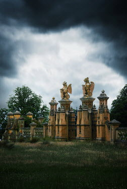 Michael Trevillion ORNATE GATES WITH DRAGONS AND STORMY SKY