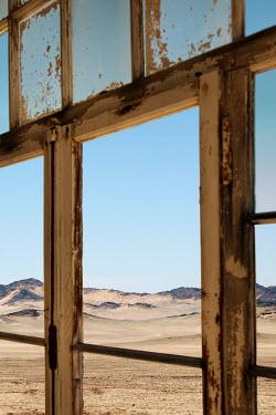 Miguel Sobreira WINDOWS OF DERELICT BUILDING IN DESERT