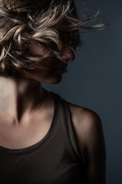 Magdalena Russocka young blonde woman with blown hair wearing tank top inside