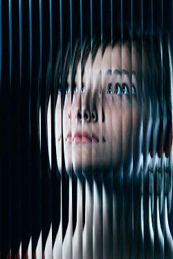 Magdalena Russocka modern woman behind distorted glass