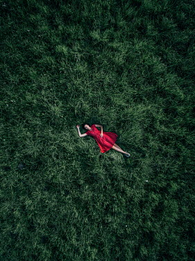 Magdalena Russocka young woman lying on grass from above