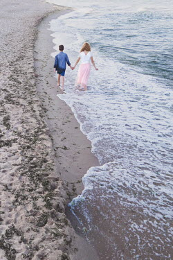Maria Petkova WOMAN AND YOUNG BOY HOLDING HANDS ON BEACH