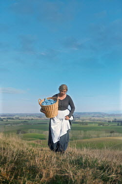 Mary Wethey HISTORICAL WOMAN CARRYING BASKET IN COUNTRYSIDE