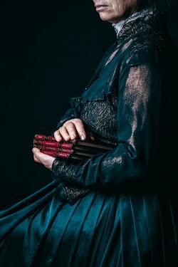 Natasza Fiedotjew old edwardian woman in black holding books