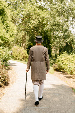 Shelley Richmond REGENCY MAN WITH HAT AND CANE WALKING ON GARDEN PATH