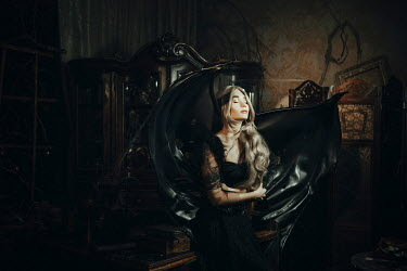Katerina Klio WOMAN IN ANTIQUE SHOP WITH BAT WINGS