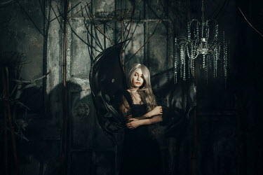 Katerina Klio WOMAN WITH BAT WINGS IN SHADOW WITH CHANDELIER