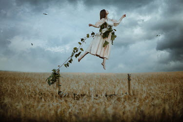 Katerina Klio FLOATING WOMAN TIED TO BED WITH VINE IN FIELD