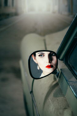 Magdalena Russocka elegant retro woman reflected in retro car wing mirror