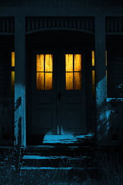 Magdalena Russocka illuminated entrance to old cottage house at night