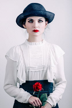 Magdalena Russocka retro woman wearing hat holding red rose