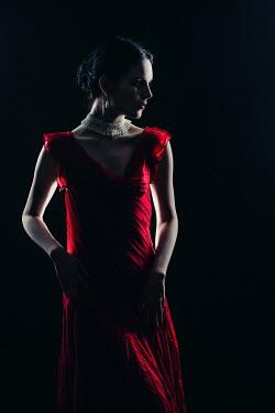 Magdalena Russocka elegant woman wearing red dress in shadow