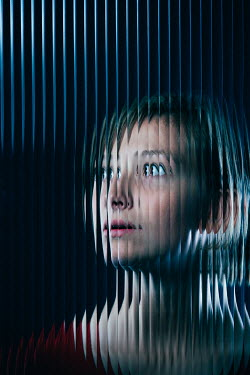 Magdalena Russocka scared modern woman behind distorted glass