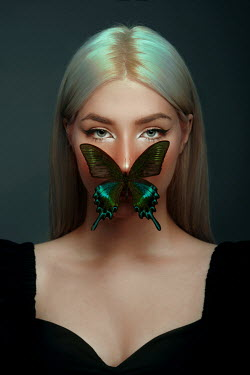 Tijana Moraca BLONDE WOMAN WITH BUTTERFLY COVERING MOUTH