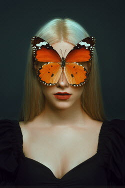 Tijana Moraca BLONDE WOMAN WITH BUTTERFLY COVERING EYES
