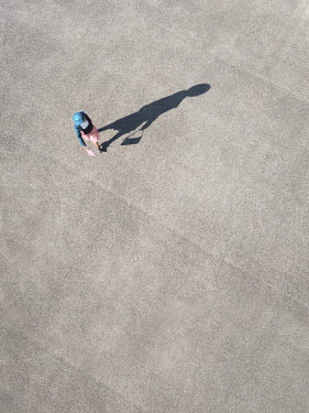 Magdalena Russocka retro woman walking on sunny pavement from above